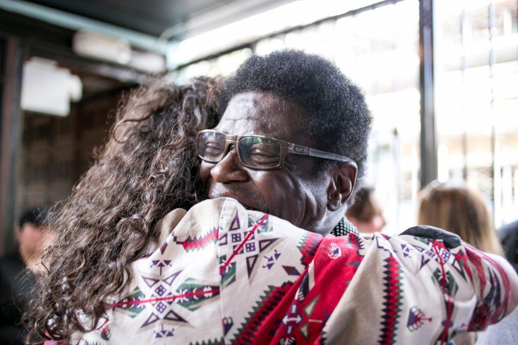 Charles Bradley hugs with girl