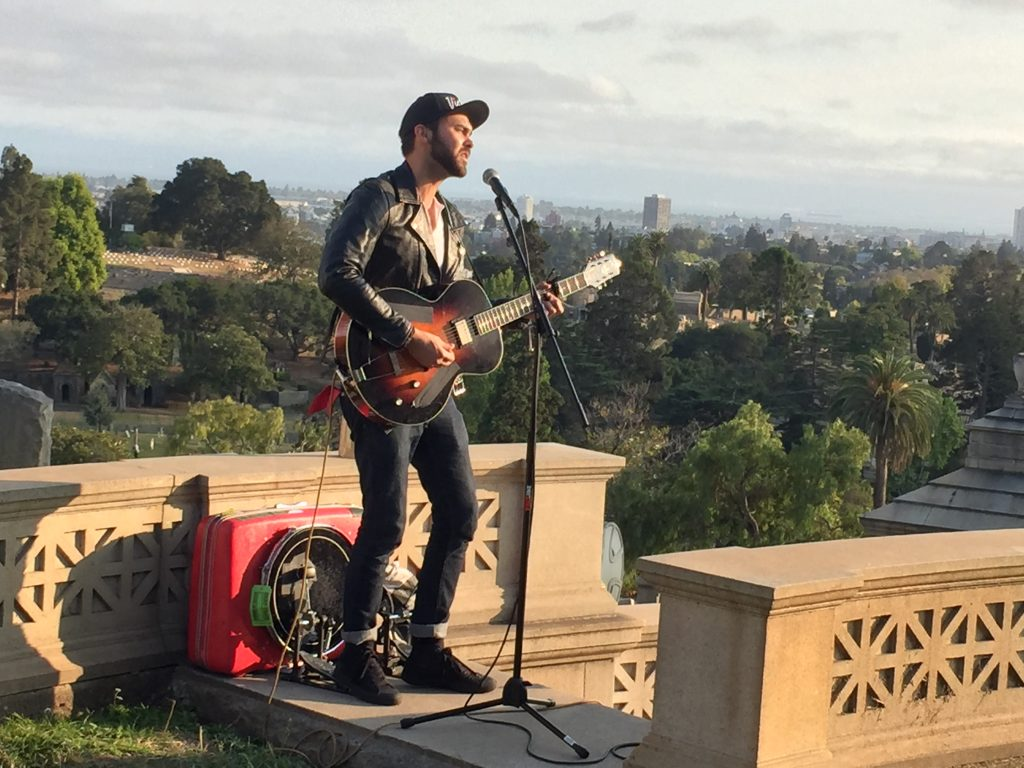 Shakey Graves singing on the stairs