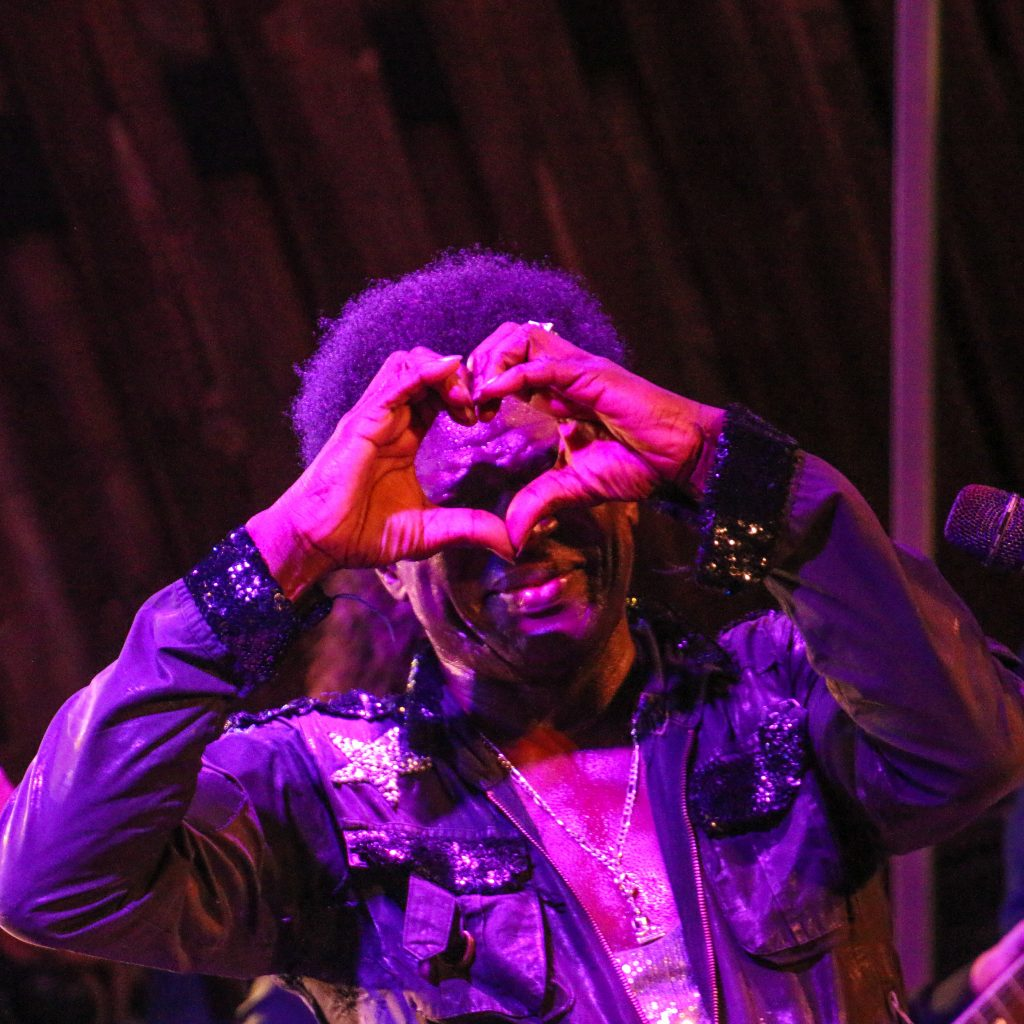 Charles Bradley showing heart by hands