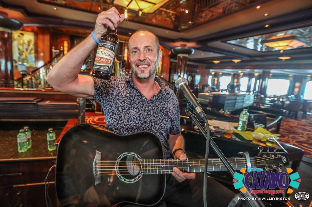 Paul Thorn with beer and guitar